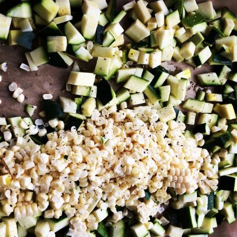corn and zucchini on baking sheet